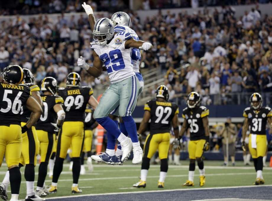 Dallas Cowboys running back DeMarco Murray (29) celebrates his touchdown against the Pittsburgh Steelers with Dez Bryant (88) during the second half of an NFL football game Sunday, Dec. 16, 2012 in Arlington, Texas. (AP Photo/Tony Gutierrez) Photo: Tony Gutierrez