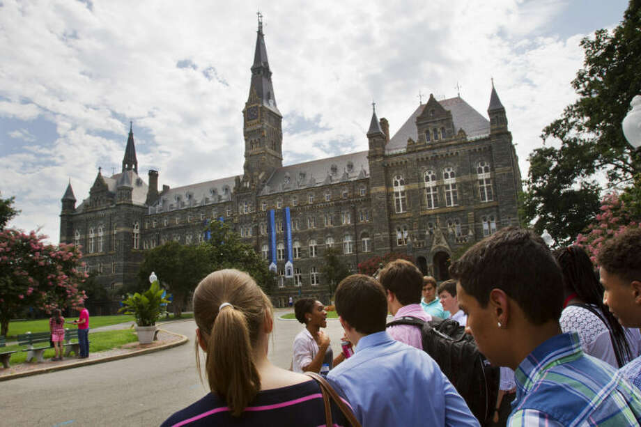 FILE - Prospective students tour Georgetown University's campus in Washington, in this Wednesday, July 10, 2013, file photo. Grants and scholarships are taking a leading role in paying college bills, surpassing the traditional role parents long have played in helping foot the bills, according to a report from loan giant Sallie Mae. (AP Photo/Jacquelyn Martin, File) Photo: Jacquelyn Martin