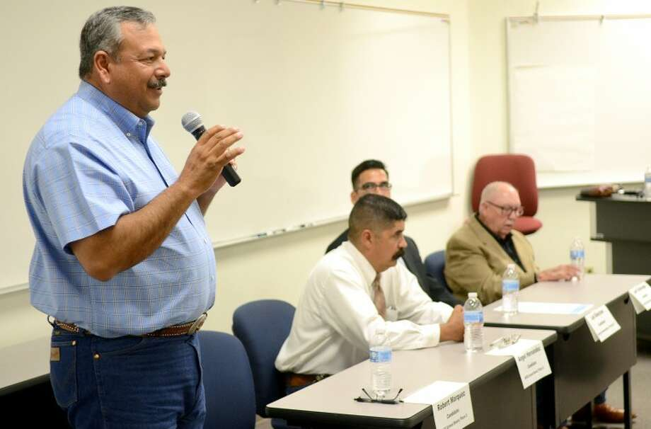 MISD school board candidate Robert Marquez speaks during a candidate forum presented by the League of Women Voters Tuesday at the Midland College Cogdell Learning Center. Running against Marquez for the district 2 school board seat is incumbent Angel Hernandez. James Durbin/Reporter-Telegram Photo: JAMES DURBIN