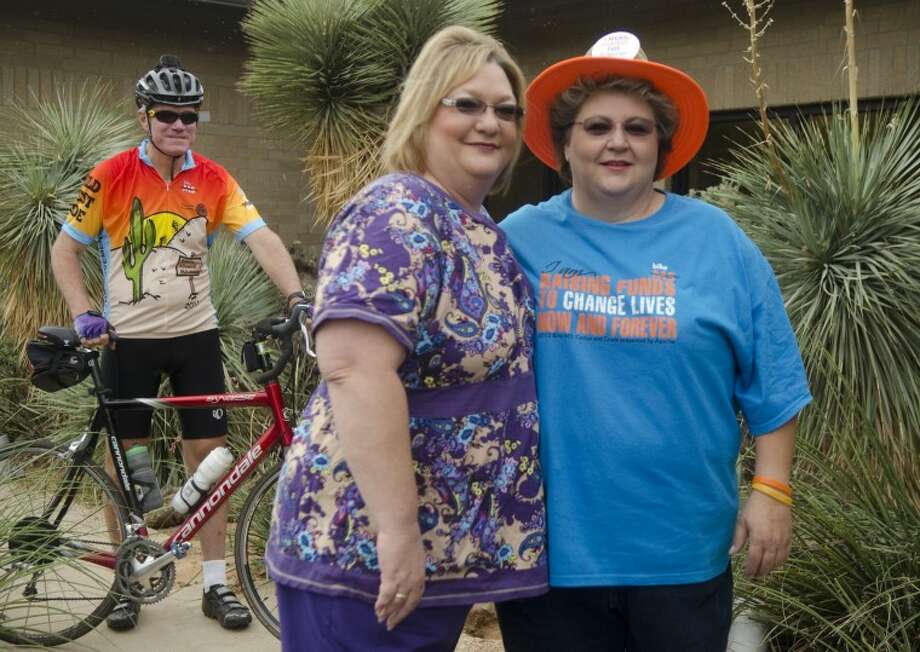 Staci Taylor, left and her sister, Renea Pitchford, participate in the Cactus and Crude Bike MS. Kent Crowell, behind, is also a big supporter of the ride to end MS. Photo by Tim Fischer\Reporter-Telegram Photo: Tim Fischer