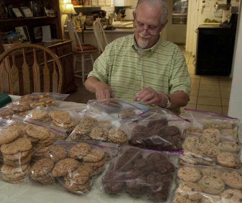 "Don ""Cookie Man"" Wedel prepares one of the dozens of batches of cookies he bakes each week to give out to area non-profit agencies. Photo: Tim Fischer/Reporter-Telegram"