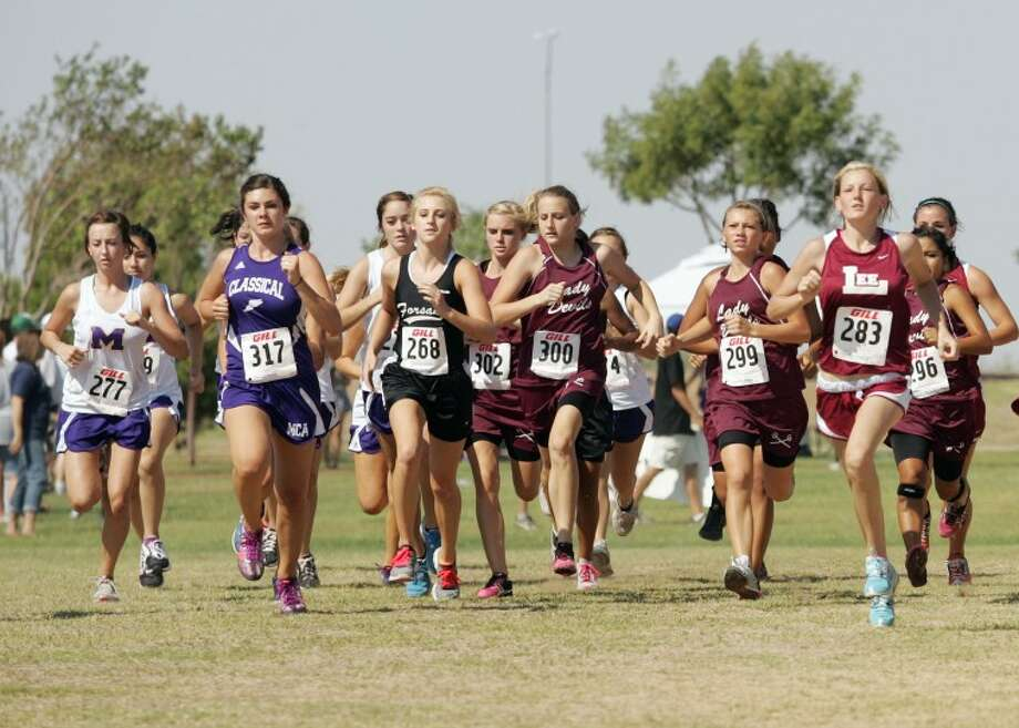 Tall City Invitational Cross Country varsity girls' runners take off from the starting line Saturday at Beal Park. Cindeka Nealy/Reporter-Telegram Photo: Cindeka Nealy