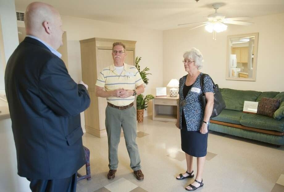Paul Cain, Midland Fairhavens board president, left, gives a tour of one of the residences Thursday to Art and Sandy Rybicki during an open house and celebration of 15 years of Fairhavens helping Midland women and families. Tim Fischer\Reporter-Telegram Photo: Tim Fischer