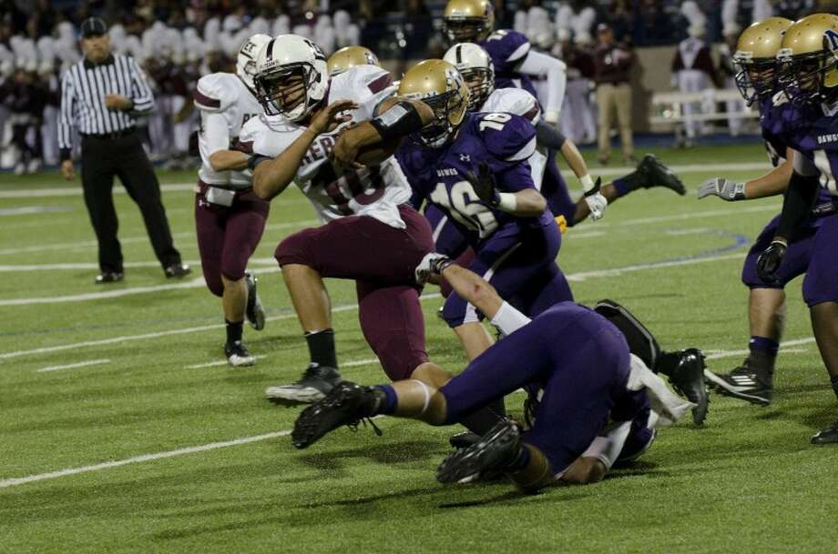 Midland Lee's Talor Nunez fights for yardage Friday night at Grande Communications Stadium. Photo by Tim Fischer/Midland Reporter-Telegram Photo: Tim Fischer