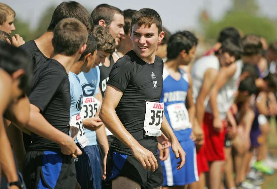 Trinity's Christian Farris talks to his teammates before the start of race Saturday during the Tall City Invitational Cross Country Meet at Beal Park. Farris placed first in the race. Cindeka Nealy/Reporter-Telegram Photo: Cindeka Nealy