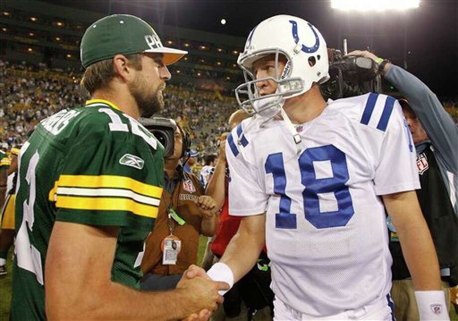 Green Bay Packers' Aaron Rodgers (12) shakes hands with Indianapolis Colts' Peyton Manning (18) after an NFL preseason football game Thursday, Aug. 26, 2010, in Green Bay, Wis. The Packers won 59-24. (AP Photo/Jeffrey Phelps) Photo: Jeffrey Phelps / FR59249 AP