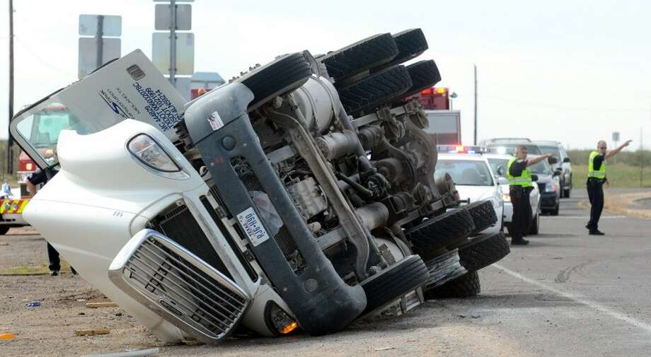 A tanker truck loaded with diesel fuel tipped over Saturday at the south Loop 250 and I-20 interchange. James Durbin/Reporter-Telegram Photo: JAMES DURBIN