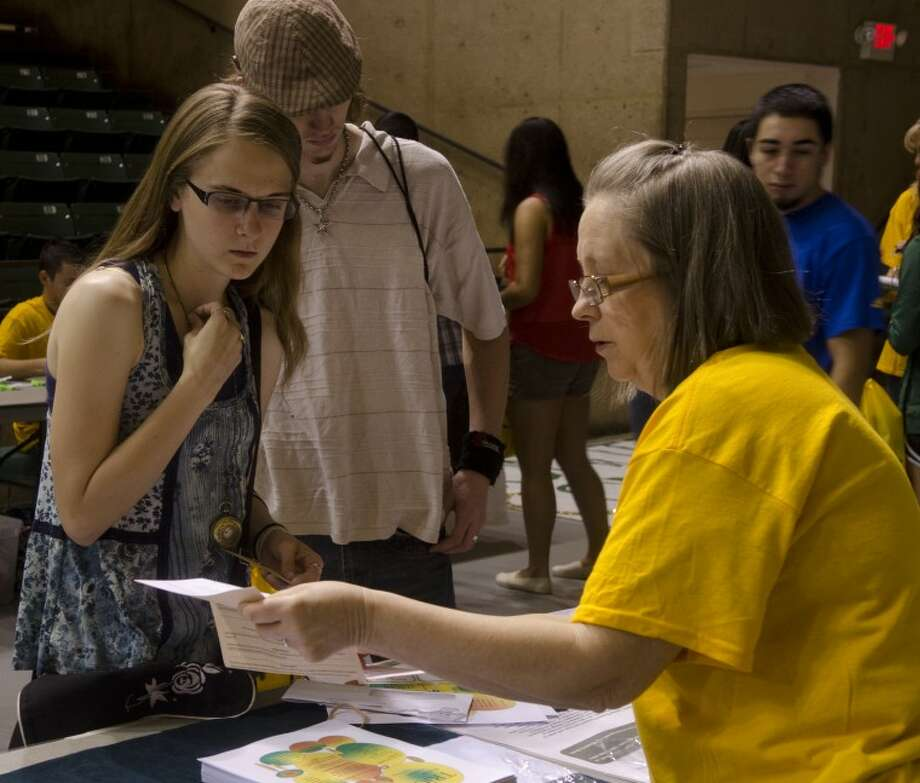 Nicole Stokes and Collin Kelso ask questions to Judy Jordan, director of student support services, Thursday at Midland College Your College Day, or orientation day in the Chap Center. Photo by Tim Fischer\ Reporter-Telegram Photo: Tim Fischer
