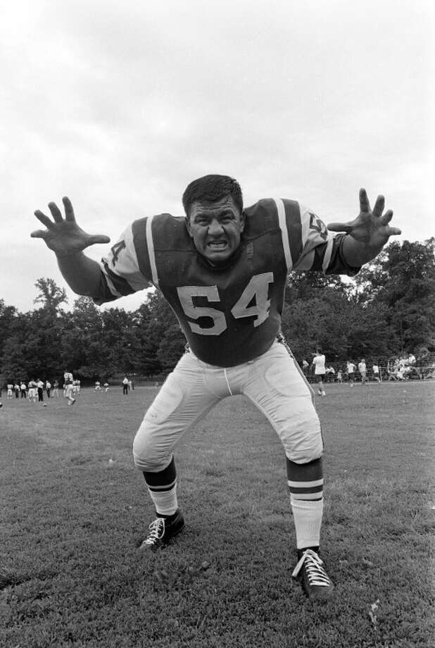 "Linebacker Edward ""Wahoo"" McDaniel of the New York Jets posed with this expression as the American Football League team opened its training camp July 15, 1965 at Peekskill Military Academy in Peekskill, N.Y. THe 240-pound McDaniel is 27 years old and hails from Midland, Tex. He's been in Pro Football for six years. (AP Photo/Dave Pickoff) Photo: DAVE PICKOFF"