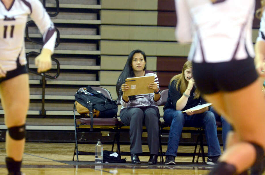 Lee girls volleyball assistant coach Cassie Hernandez looks on from the bench during the game against Abilene High on Tuesday at Lee High School. James Durbin/Reporter-Telegram Photo: JAMES DURBIN