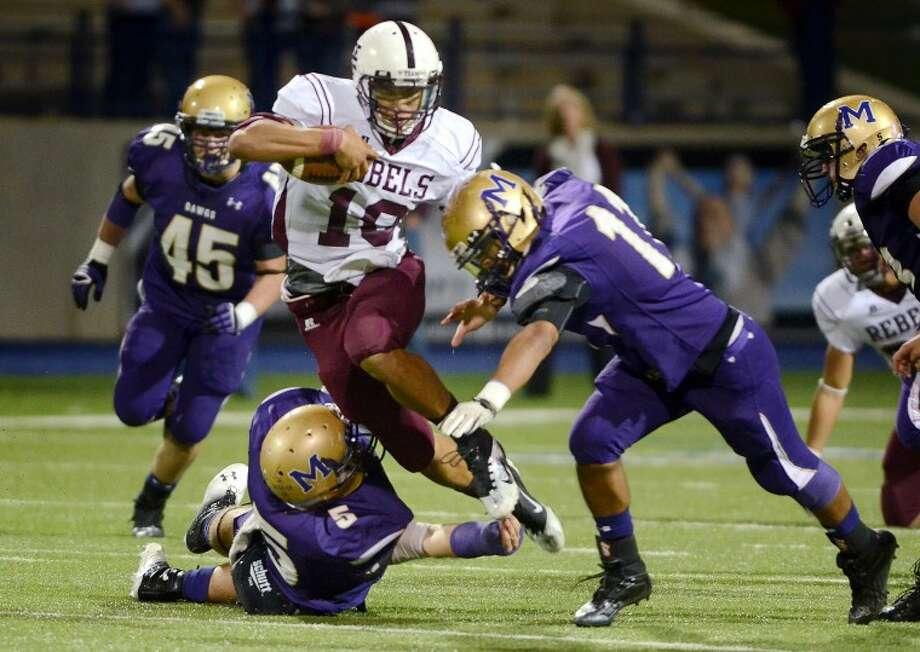 Midland Lee quarterback Talor Nunez blasts through the Midland High defense Friday at Grande Stadium in Midland. James Durbin/Reporter-Telegram Photo: JAMES DURBIN