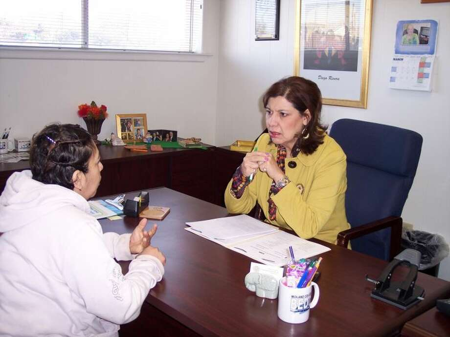 Midland College Business and Economic Development Center housing counselor Celia Molina Roux speaks with a client attempting to become mortgage ready in her office at the BEDC, 201 W. Florida Ave. Photo courtesy of the Midland College BEDC.