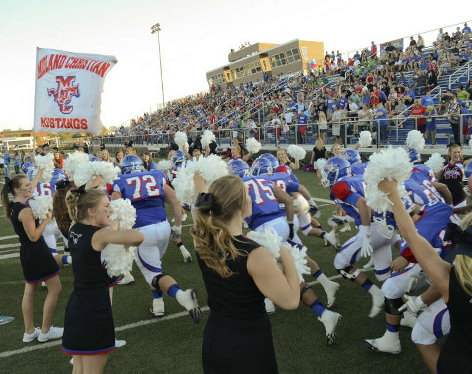 Midland Christian players take the field before an Aug. 30 game at Mustang Field. The Mustangs will play for a TAPPS Division II state championship and an undefeated season today.Tim Fischer\Reporter-Telegram Photo: Tim Fischer