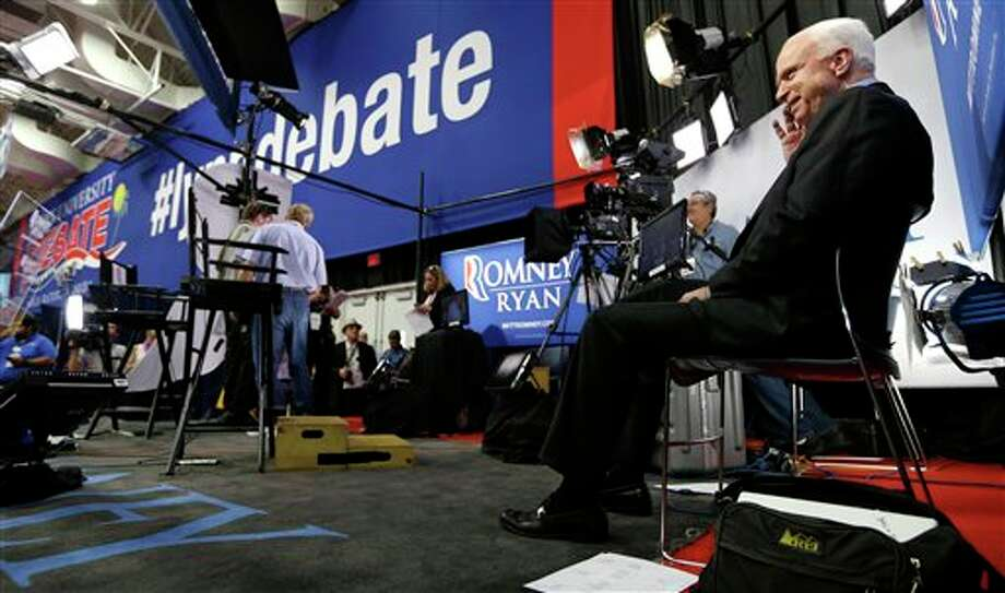 Sen. John McCain, R-Ariz. talks on the phone in the media filing center after doing a television interview before the final presidential debate between President Barack Obama and Republican presidential candidate, former Massachusetts Gov. Mitt Romney, Monday, Oct. 22, 2012, at Lynn University in Boca Raton, Fla. (AP Photo/Charlie Neibergall) Photo: Charlie Neibergall / AP