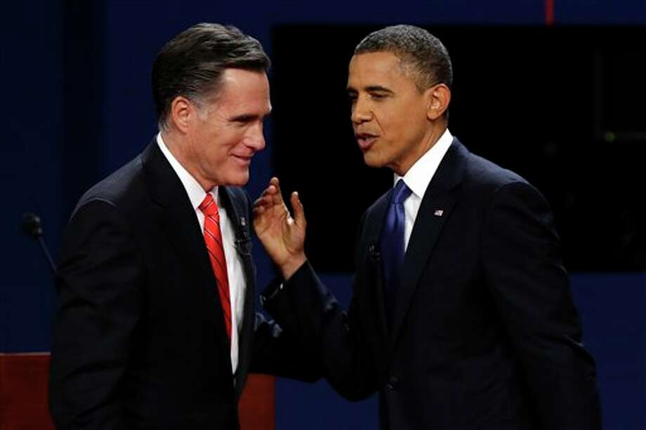 FILE - In this Oct. 3, 2012 file photo, Republican presidential candidate, former Massachusetts Gov. Mitt Romney and President Barack Obama talk after the first presidential debate in Denver. There they go again. Or do they? When President Barack Obama and Mitt Romney debate Tuesday night, the fact-checking media will be watching for the erroneous claims that have popped up repeatedly in the campaign, as well as brand new ones. Here's how you can play fact-check Whac-A-Mole, too. (AP Photo/Charlie Neibergall, File) Photo: Charlie Neibergall / AP2012