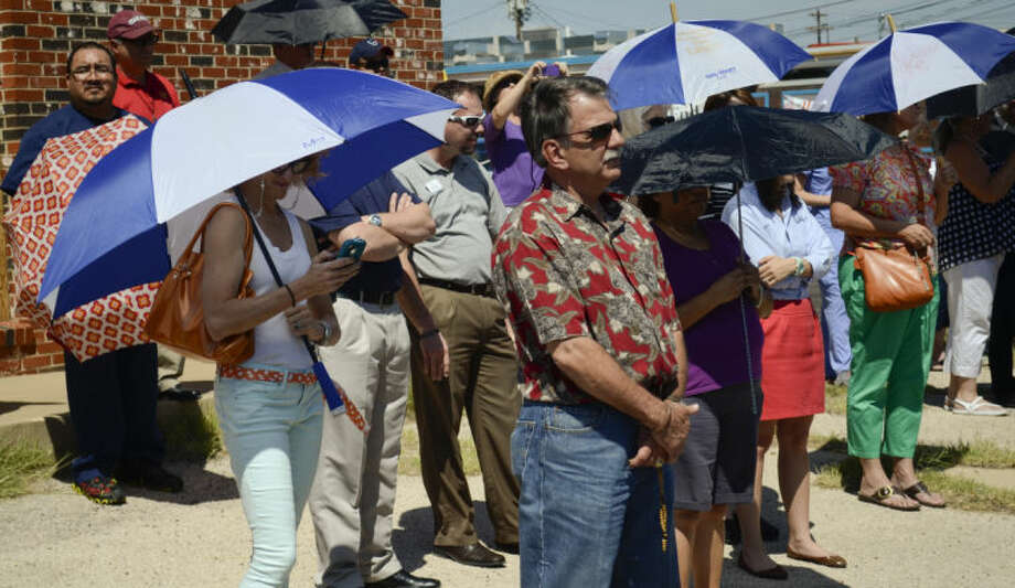 Area Catholics and Pro-Life supporters pray during the final Pro-Life rally outside the Midland Planned Parenthood building Friday afternoon. Tim Fischer\Reporter-Telegram Photo: Tim Fischer