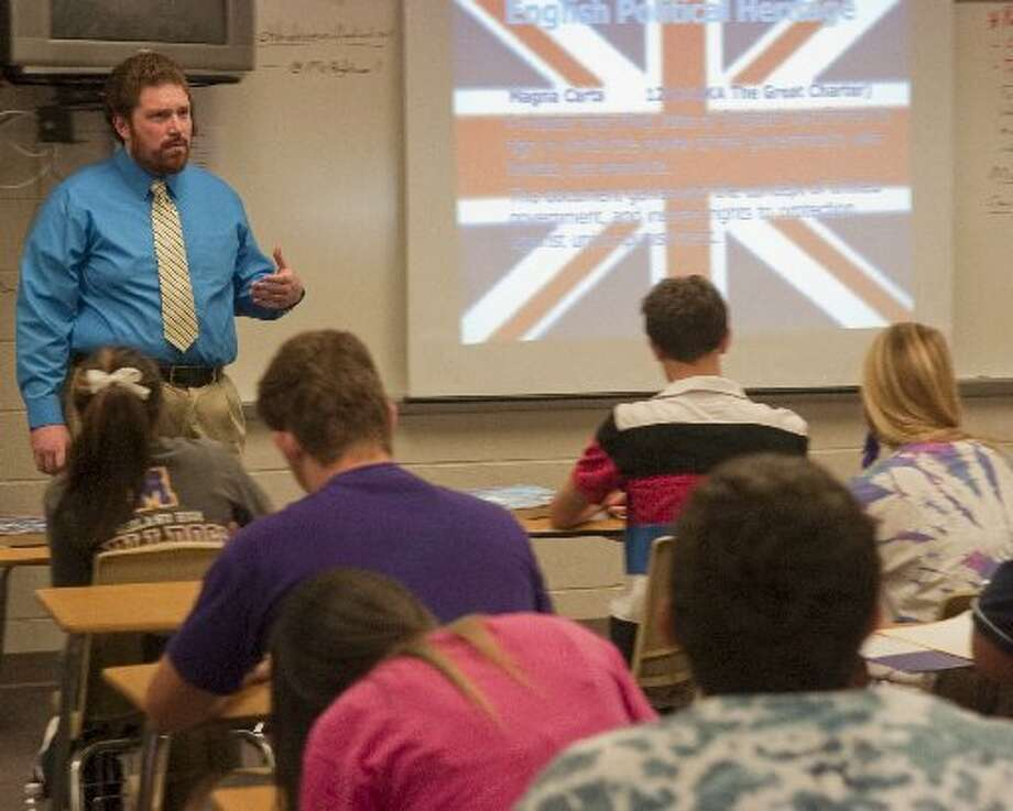 Midland High government and social studies teacher Chris Hightower talks with his students Wednesday morning in class. Photo: Photo By Tim Fischer/Midland Reporter-Telegram