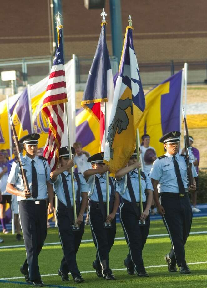 Members of Midland High Air Force JROTC present the colors Sept. 2 to start the Midland High vs. El Paso Del Valle football game at Grande Communications Stadium. Photo: Tim Fischer/Midland Reporter-Telegram