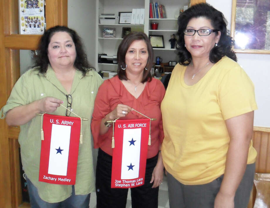 Blue Star moms Michelle Medley, Sylvia Lara and Melissa Ybarra pose with their banners honoring their sons who are serving in the military. The ladies are part of the Ozona Military Support Group that meets and helps lend a hand to those whose children are active in the military. Photo: Audrie Palmer/MRT Staff / COPYRIGHT, 2010