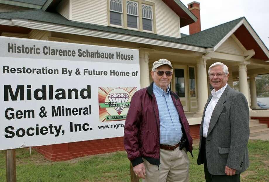 Tom Wurster and Bill Halepeska, members of the Midland Gem and Mineral Society, stand in front of the historic Scharbauer house that serves as a headquarters for the group. James Durbin/Reporter-Telegram Photo: JAMES DURBIN
