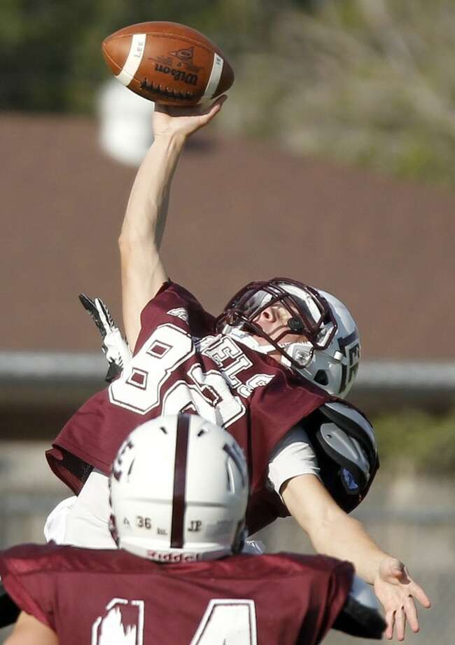 Lee High safety Logan Vitello makes a one-handed interception during football practice Wednesday at Lee. James Durbin/Reporter-Telegram Photo: JAMES DURBIN