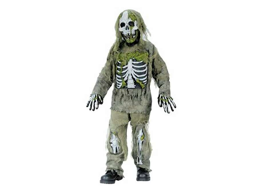 "This undated product image released by Part City shows a boys skeleton zombie costume. Catering to the popular zombie craze, Halloween costumes for young children are getting more grisly. Even costumes that were once benign now have violent twists: The sweet, simple ""sock monkey"" is now a bloody zombie sock monkey with razor-sharp teeth, sold in sizes small enough for kindergartners. (AP Photo/Party City) Photo: HOEP / Party City"