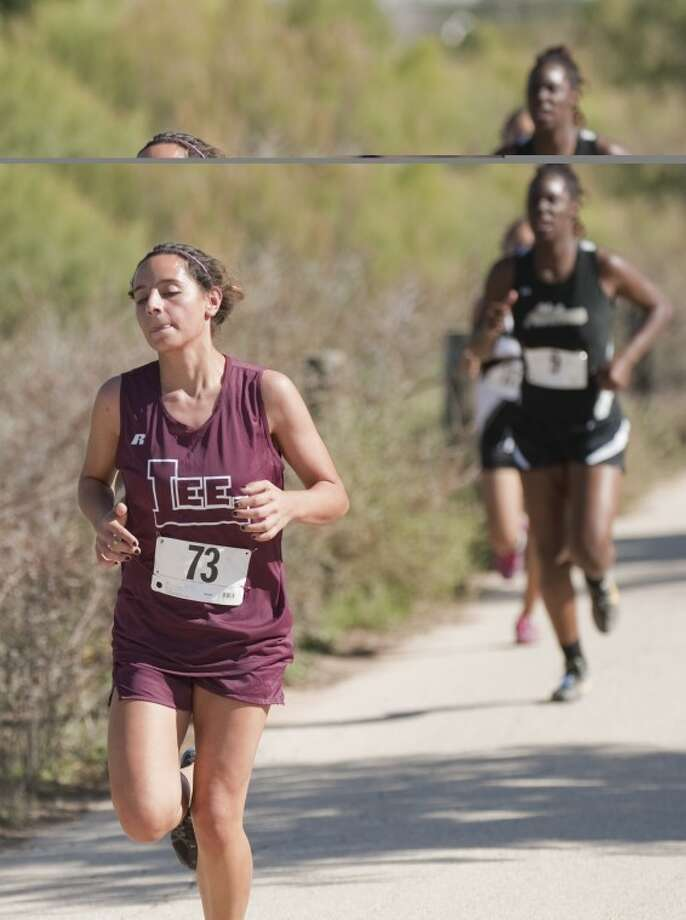 Lee's Maria Gil runs the course Thursday around UPTB Park in Odessa as she and others compete in the District 2-5A cross country meet. Tim Fischer\Reporter-Telegram Photo: Tim Fischer