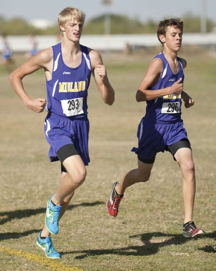 Midland High's #293 and Carter Tate run Thursday at the District 2-5A cross country meet arounf UTPB Park in Odessa. Tim Fischer\Reporter-Telegram Photo: Tim Fischer