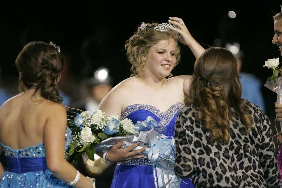 Friends of Callie Knippa congratulate her after she was crowned Greenwood's Homecoming Queen Friday night at JM King Memorial Stadium. Cindeka Nealy/Reporter-Telegram Photo: Cindeka Nealy