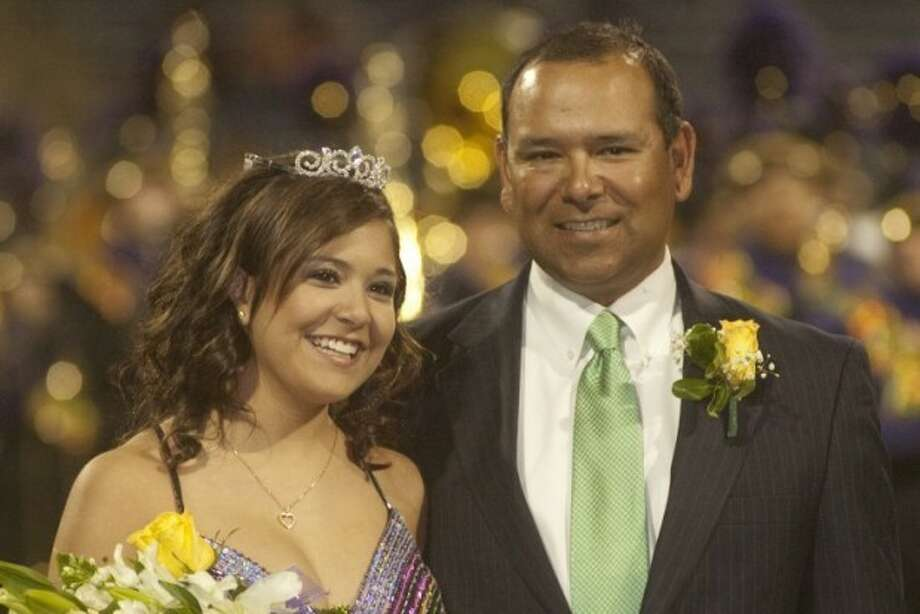 Sarah Alvarez, escorted by her father Bobby Alvarez, is crowned MHS Homecoming Queen Friday night at Grande Communications Stadium. Photo by Tim Fischer/Midland Reporter-Telegram Photo: Tim Fischer