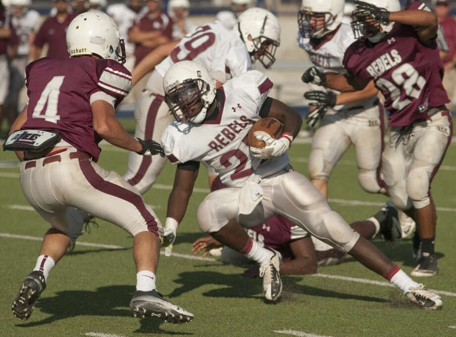 Lee White squad's Aron Dobbins tries to cut back as Lee Maroon squad's Abel Sanchez looks to stop him Friday in the annual Maroon and White Lee football game. Tim Fischer\Reporter-Telegram Photo: Tim Fischer