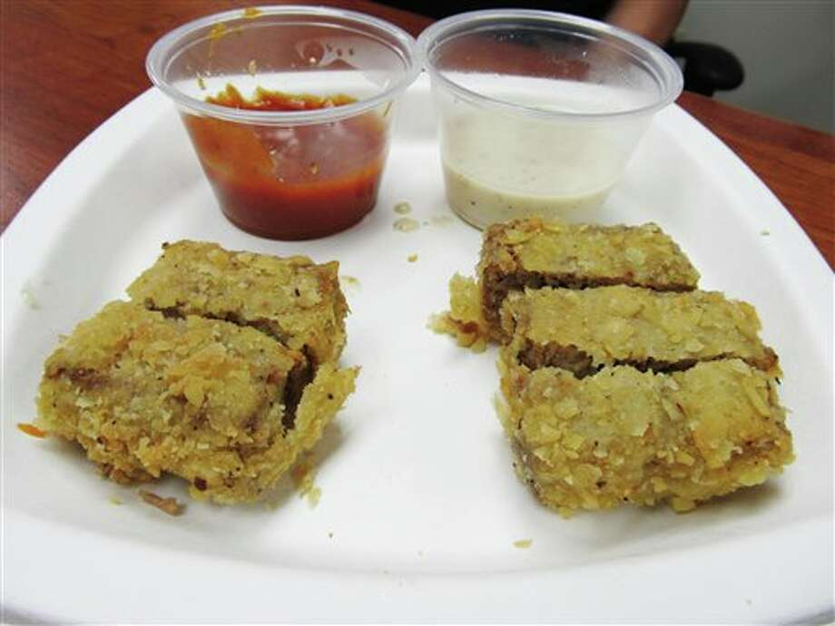 This undated photo provided by the State Fair of Texas shows southern style chicken fried meatloaf, one of eight finalists for the State Fair of Texas Big Tex Choice Awards. Winners for Best Taste and Most Creative new foods will be selected Sept. 2 by a three-judge panel. (AP Photo/State Fair of Texas) Photo: HOEP / State Fair of Texas