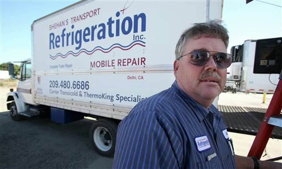 This photo taken Oct. 25, 2012 shows Kelly Cox, co-owner of Shehan's Transport Refrigeration in Delhi, Calif. Who are these people who still can't make up their minds? They're undecided voters like Cox, who spends his days repairing the big rigs that haul central California's walnuts, grapes, milk and much more across America. He doesn't put much faith in Barack Obama or Mitt Romney. (AP Photo/Gary Kazanjian) Photo: Gary Kazanjian / FR71556 AP