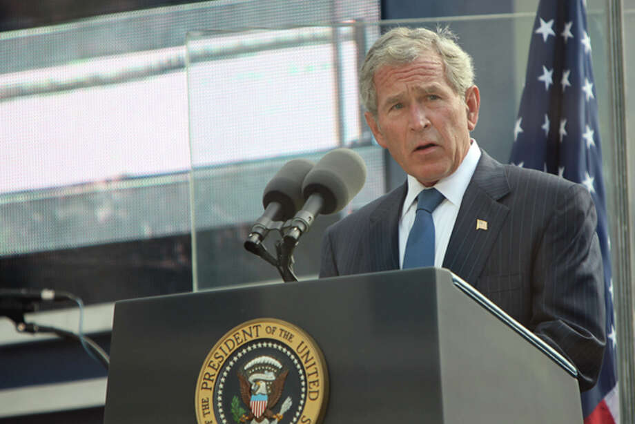 Former United States President George W. Bush addresses those attending the 10th anniversary commemoration of the terrorist attacks on the World Trade Center, Sunday, Sept. 11, 2011 in New York. (AP Photo/Allen Tannenbaum, Pool) Photo: Allan Tannenbaum / Allan Tannenbaum