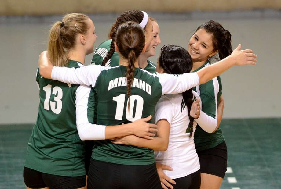 The Midland College volleyball team celebrates after beating New Mexico Military Institute Saturday at the Chaparrel Center. James Durbin/Reporter-Telegram Photo: JAMES DURBIN