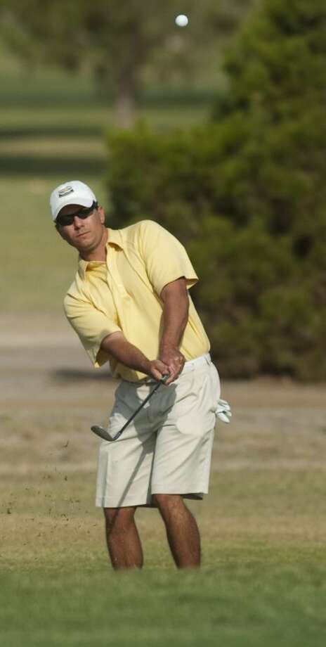 Daniel Pender watches his chip shot Saturday at Midland Country Club in the MIT Golf Tournament. Photo by Tim Fischer/Midland Reporter-Telegram Photo: Tim Fischer