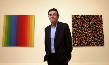 Director Neal Benezra in front of works by Ellsworth Kelly, Spectrum I, 1953, (left) and  Spectrum Colors Arranged by Chance, 1951-53, at the new San Francisco Museum of Modern Art  in San Francisco, California, on Thurs. May 5, 2016.