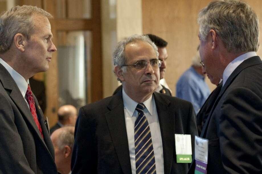 John Zogby, center, talks with Mark Merritt and Doug Robison Thursday at the Permian Basin Petroleum Association annual meeting luncheon. Tim Fischer\Reporter-Telegram Photo: Tim Fischer