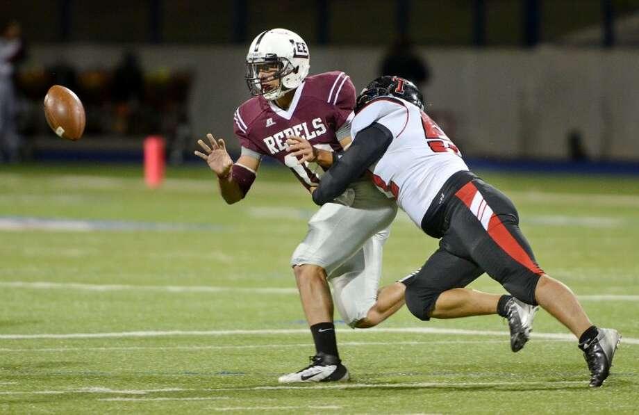 Midland Lee quarterback Talor Nunez passes as he is hit by a Tascosa High defender Friday at Grande Communications Stadium. James Durbin/Reporter-Telegram Photo: JAMES DURBIN
