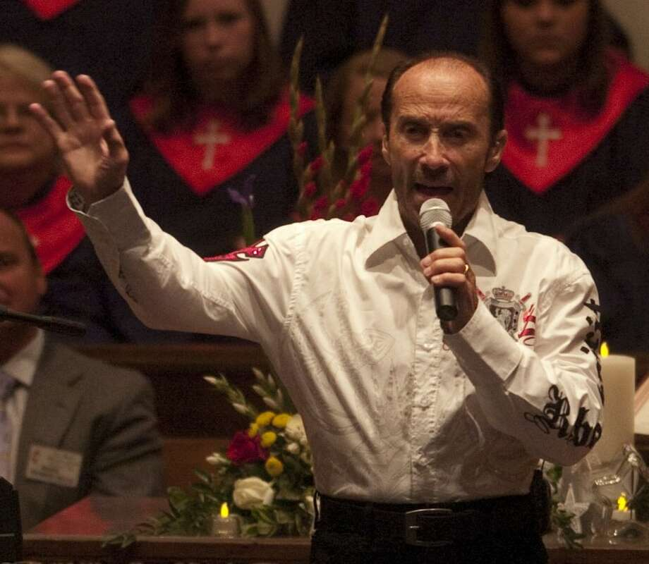 Recording artist Lee Greenwood performs Sunday at First United Methodist Church as part of Remembrance Services on the 10th anniversary of September 11. Photo by Tim Fischer/Midland Reporter-Telegram Photo: Tim Fischer
