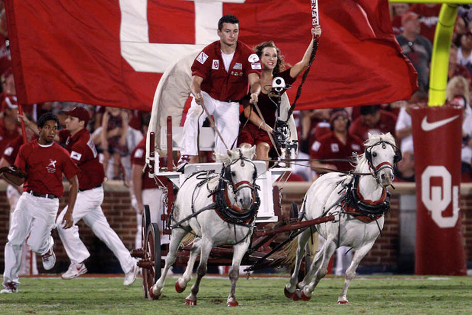 The Sooner Schooner comes onto the field to celebrate an Oklahoma touchdown against Tulsa in the third quarter of an NCAA college football game in Norman, Okla., Saturday, Sept. 3, 2011. Oklahoma won 47-14. (AP Photo/Sue Ogrocki) Photo: Sue Ogrocki / AP
