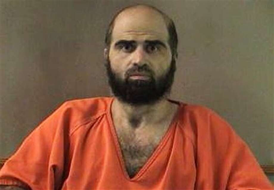 FILE - This undated file photo provided by the Bell County Sheriff's Department shows Maj. Nidal Hasan. Hasan has been convicted of murder for the 2009 shooting rampage at Fort Hood that killed 13 people and wounded more than 30 others. Hasan and many of his victims seem to want the same thing - his death. But while survivors and relatives of the dead view lethal injection as justice, the Army psychiatrist appears to see it as something else - martyrdom. (AP Photo/Bell County Sheriff's Department, File) Photo: HOPD / Bell County Sheriff's Department