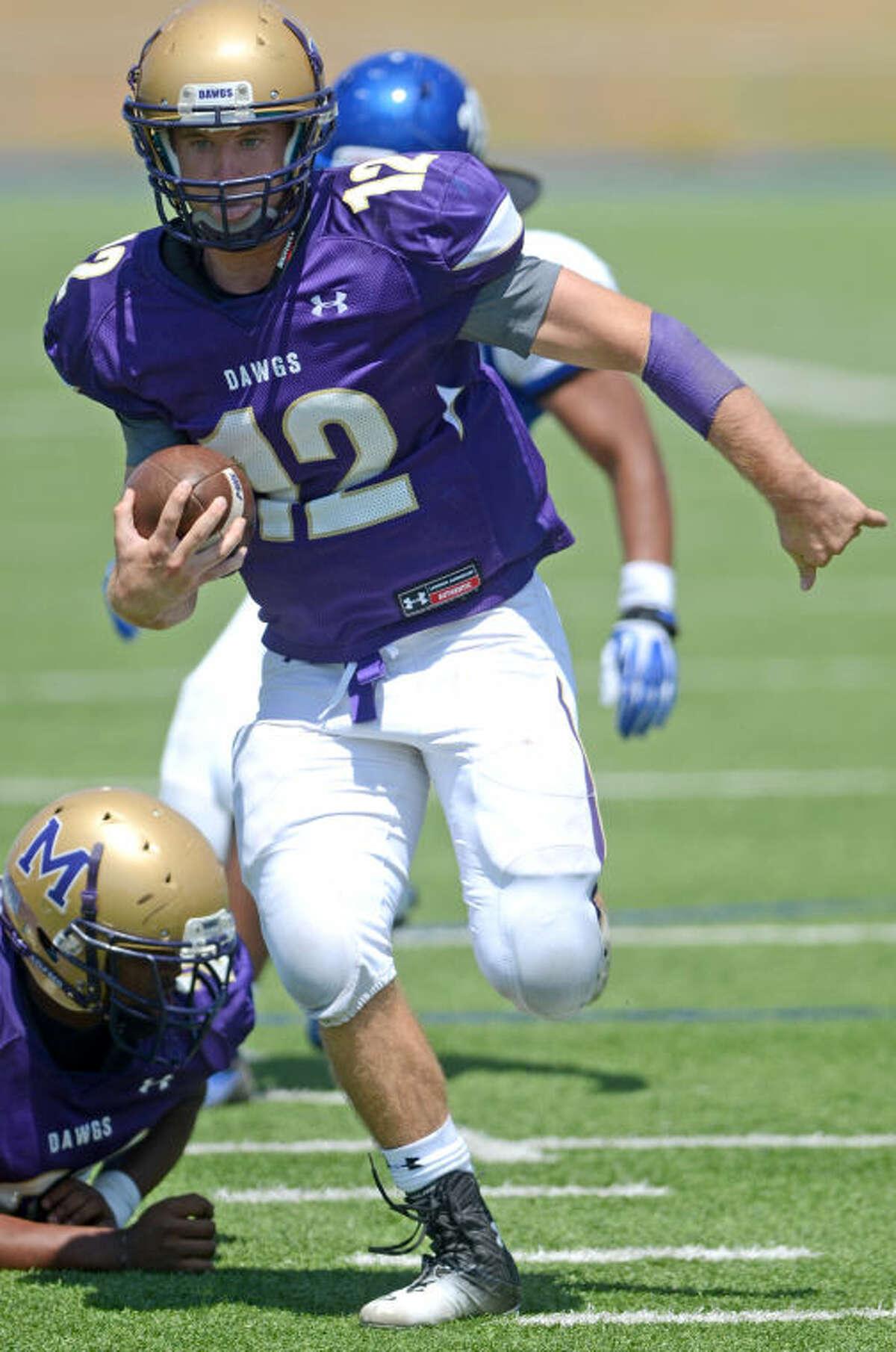 Midland quarterback Sam Grimes runs the ball in for a touchdown against EP Americas Saturday at Grande Communications Stadium. James Durbin/Reporter-Telegram