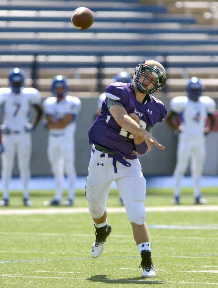 Midland High quarterback Sam Grimes throws during the game against El Paso Americas Saturday at Grande Communications Stadium. James Durbin/Reporter-Telegram Photo: JAMES DURBIN
