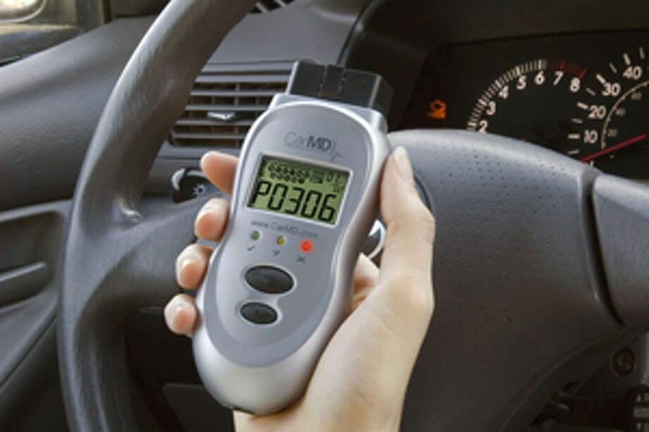 This undated product image courtesy of CarMD.com Corporation shows the CarMD handheld monitor. CarMD has created a hand-held diagnostic gadget that plugs into a car's computer to monitor sensors, brakes and safety systems, and let you know just what might have caused a light to go on. Photo: (AP Photo/CarMD.com Corporation) / CarMD.com Corporation