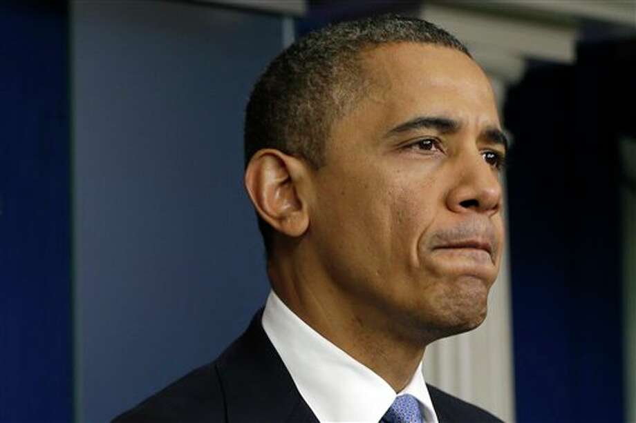 President Barack Obama pauses in the White House Briefing Room in Washington, on Monday, Oct. 29, 2012, where he spoke after returning to the White House from a campaign stop in Florida to monitor Hurricane Sandy. (AP Photo/Jacquelyn Martin) Photo: Jacquelyn Martin / AP