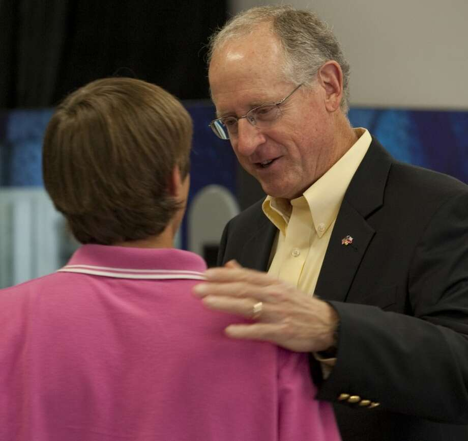 Representative Mike Conaway talks with Adam Ball Tuesday before speaking to Trinity School government and history students. Tim Fischer\Reporter-Telegram Photo: Tim Fischer