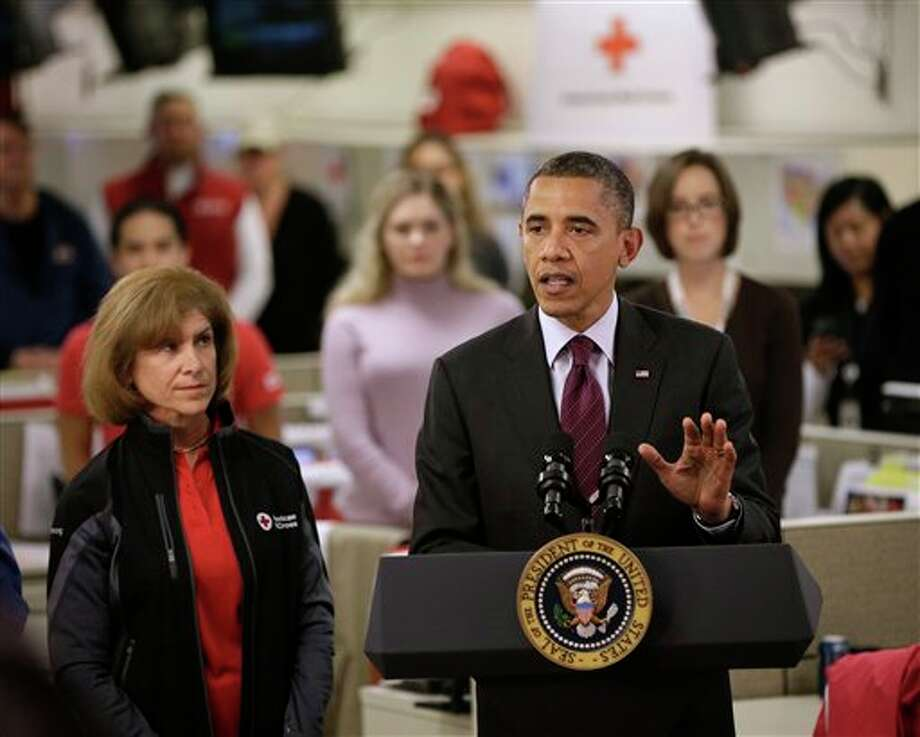 President Barack Obama, accompanied by American Red Cross President and CEO Gail J. McGovern, gestures while speaking during the his visit to the Disaster Operation Center of the Red Cross National Headquarter to discuss superstorm Sandy, Tuesday, Oct. 30, 2012, in Washington. (AP Photo/Pablo Martinez Monsivais) Photo: Pablo Martinez Monsivais / AP2012