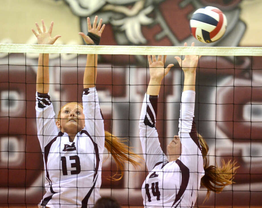 Lee's Tori Jordan (13) and Darby O'Grady (14) try to block a hit from Abilene Tuesday at Lee High. James Durbin/Reporter-Telegram Photo: JAMES DURBIN