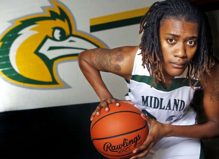 Midland College women's basketball player and all-conference pick Achire Ade poses for a portrait Thursday at the Midland College Physical Education Building gymnasium. James Durbin/Reporter-Telegram Photo: JAMES DURBIN